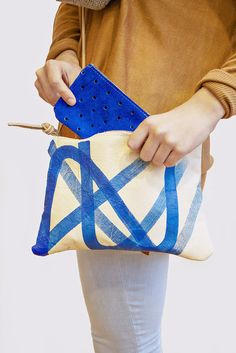 Not only is this bag super handy but the blue against the tan just makes your look POP!