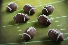 Oreo (football) truffles: 1 pkg Oreos & 8 oz. cream cheese 1. Finely crush 7 cookies in a food processor. Reserve for later. 2. Crush remaining cookies and stir in 8 oz. softened cream cheese. 3. Shape the mixture into little footballs, dip once in chocolate, tap off extra and let dry. 4. Pipe rings on each end and the laces on top. #UltimateTailgate #Fanatics