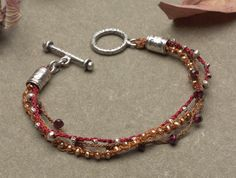 Make a Fall themed bracelet from Beaded Macrame Jewelry Book by Sherri Haab-ON SALE with code BOOK40 #Macrame #Bracelet