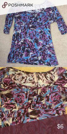 Blue/purple/black/gray printed shirt Blue,purple,gray,and black printed shirt. It has loops for a belt right below the chest Rue 21 Tops