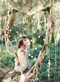 ceremony backdrop hanging from trees