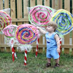 Giant tissue paper lollipops for Addi's Candyland birthday party! :)