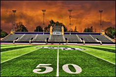 Football stadium field 50 yard line - a summer storm brewing over the 50 yard line at O'Shaughnessy football field stadium, University of St. Thomas in Saint Paul, Minnesota - Go Tommies!