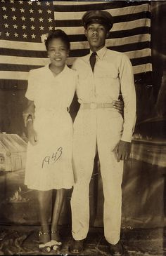 Vintage photo, African American couple in front of an American flag, 1943