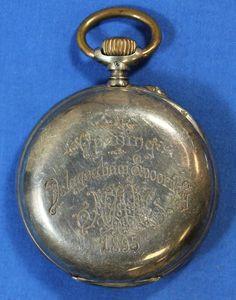 "relogio 1895 2 - No verso: ""Opening - Delagoabaai Spoorweg 1895""."