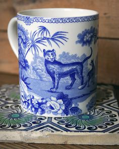 Spode's Aesop's fables blue and white transferware mug on antique Turkish tile. The Blue Room collection.