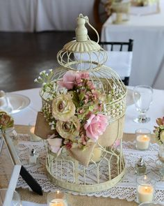 "Beautiful Centerpieces wrapped in burlap ribbon and vintage silk flowers Total of 15 Ten- 18"" tall Five- 15"" tall $18 each"