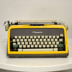 Custom Olympia SM-7 Yellow Typewriter.