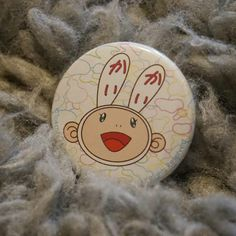 My favorite button from one of my favorite artists, Takashi Murakami. The Kaikai Kiki button is exclusive to Complex Con. #Nakanarilife #complexcon #kaikaikiki #takashimurakami #pins
