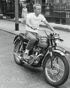 """The """"Cooler King"""" Mondays Steve McQueen riding a motorcycle Triumph TR6 650 cm3 While simplicity, a tshirt, a jeans, boots and a Triumph ... What Else ? The style, the risk and freedom on the streets of London, September 1963 #IconInspiration This is #GentlemanModern #SteveMcQueen #McQueen #Triumph #TriumphMotorcycle #TR6 #Triumphlegend #London #kingofcool #Actor #Motorcycle #Coolman #SimpleMan #Manliness #Iconofstyle #StyleIcon #Rebel #Masculinity #instacool #inspiration #love #idol…"""