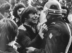 Two childhood friends meet during a demonstration. One is a striker, the other one, a policeman. Saint-Brieuc, France, 1972.