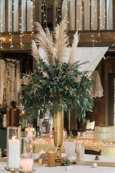 Rustic Glam centerpiece, protea, pampas grass, greenery, reception statement piece, greenery, antler, candle, candlestick, gold centerpiece, tall centerpiece #weddingcandlestick
