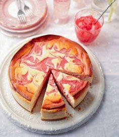 Rhubarb and Lemon Baked Cheesecake: This show-stopping dessert will impress even the most discerning sweet tooth. The tart rhubarb curd rippled through creamy lemon baked cheesecake looks and tastes absolutely gorgeous. Lemon Cheesecake Recipes, Rhubarb Recipes, Rhubarb Desserts, Cheesecake Cake, Food Cakes, Cupcake Cakes, Cupcakes, Rhubarb Curd, Just Desserts