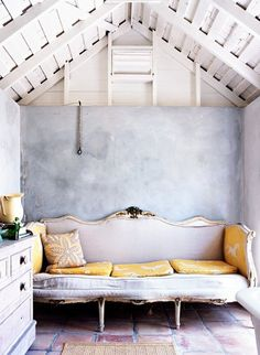 soft palette of grey and yellow in a vintage inspired room.