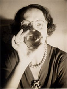 """A woman smiling through glass. One of the photographs featured in the documentary """" Other People's Pictures."""" Most intriguing is the collector who seeks out what he calls """"banality of evil,"""" photographs of nazi officers in their everyday lives."""