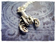 A lobster sterling pendant charm.