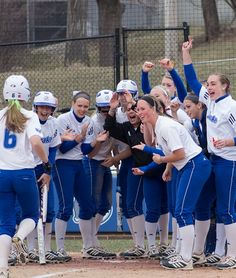 """April 18, 2013: """"Round the Bases."""" The Drake women's softball team congratulates infielder Amy Pierce, a junior from Olathe, Kan., on a home run. Photo by Baron Cao, sophomore actuarial science & mathematics double major."""