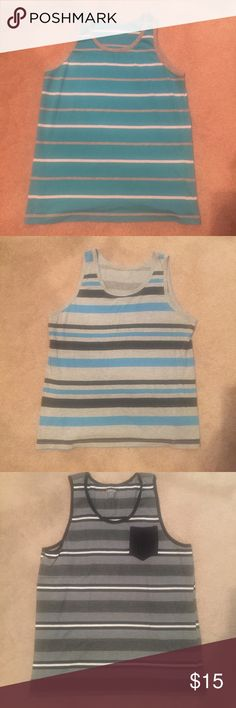 5 Men's Medium Tank Tops 1. Medium Carbon brand light blue stripped tank top 2. Medium Carbon gray and blue stripped tank top 3. Medium Carbon black and gray stripped tank top 4. Medium Arizona white, gray and black tank 5. Medium Old Navy black and gray stripped tank.                    If interested in one in particular let me know. Prefer selling all together. Originally 10$ each Rue 21 Shirts Tank Tops