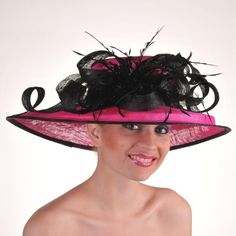 Black/Fuchsia Pink Feather Sinamay Couture: http://www.hat-a-tude.com/ecommerce/kentucky-derby-hats/kentucky-derby-hats-black/black-fuchsia-pink-feather-sinamay-couture.php