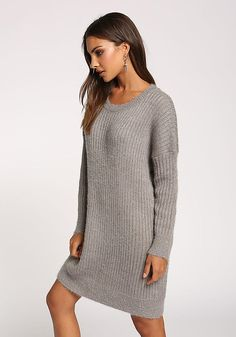 4a36d48bf8 A minimalist and stylish tunic sweater top that features a fuzzy ribbed  knit bodice. Long sleeved with a round neckline and boxy silhouette.