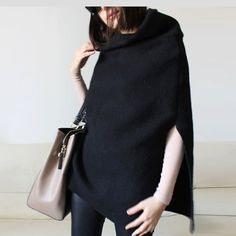 This black cape is made of felted wool fabric, which is soft and warm. Suitable for spring and autumn . Very elegant and cozy at the same time.   I