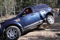 Land Rover LR2, off road, wheel in the air!  Land Rovers know how to do it right!
