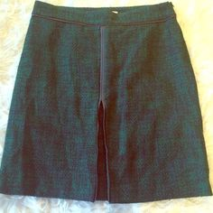 """Green and navy tweed skirt Pencil skirt with a bit of flair, small faux leather details at the waist and down the front. Pleated slit, but not gap. Length: 22.25, waist: 17.5"""" hips: 21"""". This item is used and may have imperfections. Small snag, not noticeable while wearing. Liz Claiborne Skirts A-Line or Full"""