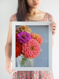 Zinnias are so cheerful! This print will add color to any room and the different colors means that it will fit in with almost any color scheme. Display it on its own or with other colorful pieces, the choice is yours! The photo is professionally printed on Kodak Professional Supra Endura VC Digital Paper with a lustre coating for a matte finish.    The third photo shows the square crop of this print.    Please choose your size at checkout:  5x5 in. (12.7 x 12.7 cm)  5x7 in. (12.7 x 17.78 cm)…