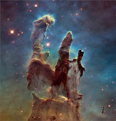 The Hubble Space Telescope has taken a new photo of one of its most iconic vistas, the Eagle Nebula's Pillars of Creation. (NASA/ESA/Hubble Heritage Team)