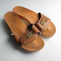 original wood dr. scholl's slip ons. 70s. shoes. slides..via Etsy. (I had blue ones) :> )