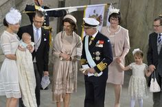 Swedish Prince Oscar's Christening Ceremony.  Crown Princess Victoria holding Oscar with her husband Prince Daniel, her mother Queen Silvia, her father, King Carl Gustaf and Mr. and Mrs. Westling, Daniel's parents with Princess Estelle, their granddaughter and Daniel and Victoria's daughter.