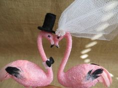 Glitzy Bride and Groom Pink Flamingo Love Birds are perfect for your wedding cake. Groom has handmade felt top hat and bow tie. Bride has