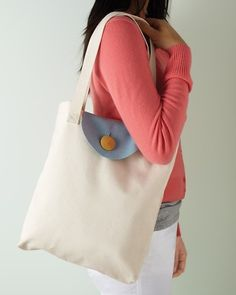 Another cute tote design. I like the over-flap with the button closure.