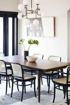32 Stylish Dining Room Ideas To Impress Your Dinner Guests: 37 Stylish Minimalist Dining Room Design Dining Room Lighting, Dining Room Chairs, Dining Room Furniture, Dining Rooms, Wood Chairs, Wood Table, Cane Chairs, Rattan Chairs, Table Lighting