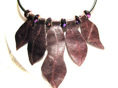 Reddish-brown Leather Leaf, Purple Faceted Bead Necklace on 4mm Leather cord. $29.00, via Etsy. #leatherjewelry,