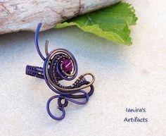 OOAK Adjustable wire wrapped gunmetal purple ring by Ianira, €22.00