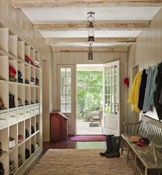 Farmhouse style entry, love the beams and LOOK at all the storage in those cubbies!   100+ Beautiful Mudrooms and Entryways at Remodelaholic.com