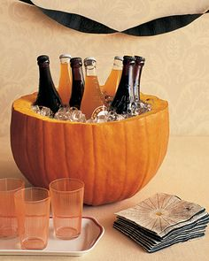 Pumpkin Party Cooler  - Hollow pumpkin holds drinks or you can put a glass bowl in the hollowed pumpkin to hold punch or cider at a Fall party.