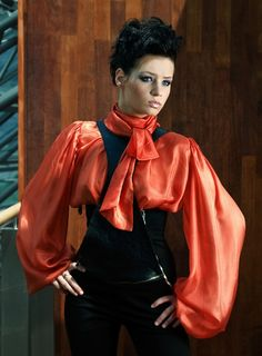 Pouffy red satin bow blouse.