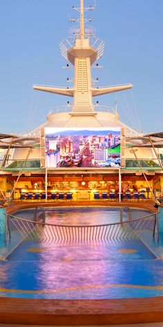 Rhapsody of the Seas | Come Seek this incredible, massive outdoor television screen perfect for movie nights by the pool, and click to discover more onboard activities available on this Royal Caribbean Vision Class ship.