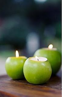 @Megan Ward Chavez Megan! - what if you could do this w PLUMS?... Carve out the top of the apple and place a tea light inside. This way, you save on floral arrangement costs! Love it!