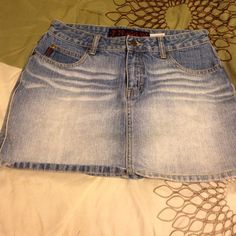 Cute Jean mini skirt for summer Light colored Jean mini shirt with front and back pockets in a size 7. Great condition. Super cute on the beach or at the lake. Mudd Skirts Mini