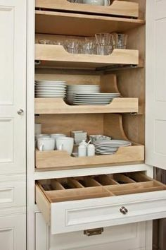 kitchen organization...pull out drawers (and all white dishes for easy mix and match) by lolita