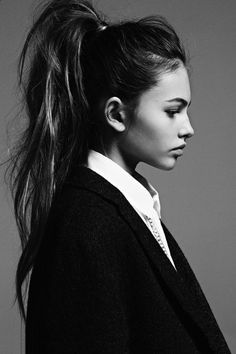 A young girl with a ponytail _ facial profile