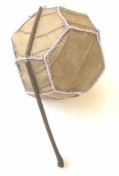 Truncated octahedron by Susanna Bauer, made of magnolia leaves sewn together with cotton yarn!