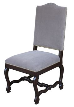 """Although the English translation, """"bone of mutton"""", may not sound very regal, our elegant Os de Mouton dining chair would make Louis XIV proud. Hand carved from American hardwood and upholstered with a contrast of delicate cream damask and velvet."""