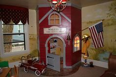 @Heather Dumford thought of you guys when I saw this!  built-in play firehouse in kid's room