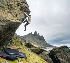 www.littlerugshop.com Batman Mountain... That was what we had nicknamed the steep peaks of Vestrahorn. But our objective was a bit lower than that. Seeking out boulders that had fallen from the peaks above and even sampling a bit of the surf.  @chris_sharma & @paulrobinson87 dispatched almost everything they saw.. But watching them get into a 5mm suit was my favorite part. by chrisburkard