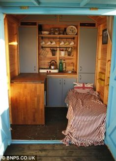 Making a hut a home! See inside the beach cabin that can be quickly transformed into a kitchen, bedroom or even an office Beach Hut Decor, Beach Huts, Small Space Living, Small Spaces, Beach Hut Interior, Small Room Bedroom, Bedroom Office, George Clarke Amazing Spaces, Hut House