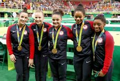 Gold medalists Alexandra Raisman, Madison Kocian, Lauren Hernandez, Gabrielle Douglas and Simone Biles of the United States pose for photographs with their medals after the medal ceremony for the Artistic Gymnastics Women's Team on Day 4 of the Rio 2016 Olympic Games at the Rio Olympic Arena on August 9, 2016 in Rio de Janeiro, Brazil.